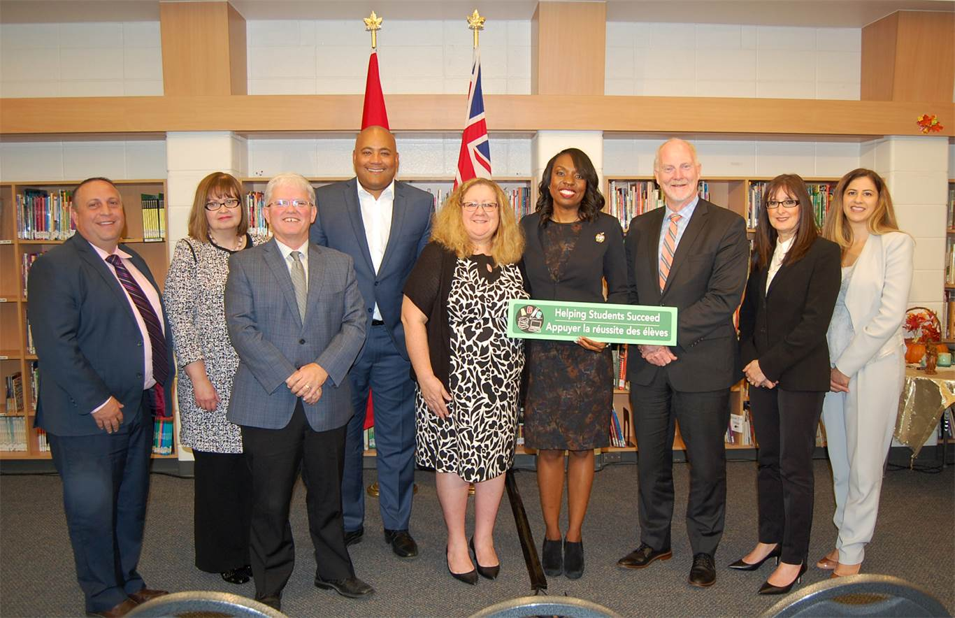 From left to right: Joe Curto, Vice-Principal, St. Michael; Donna Zan, Director of Services, Catholic Children's Aid Society of Hamilton; HWCDSB Chairperson Patrick Daly; The Honourable Michael Coteau, Minister of Children and Youth Services; Mary Jane Rossi, Principal, St. Michael CES; The Honourable Mitzie Hunter, Minister of Education; David Hansen, Director of Education; Toni Kovach, Superintendent of Education; Jenny Athanasiou-Malisa, Manager of Social Work Services.
