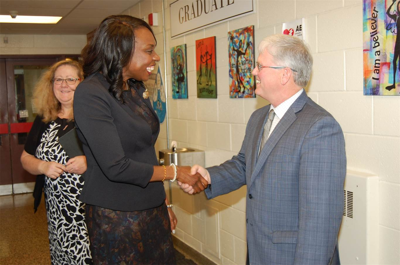 Minister of Education Mitzie Hunter speaks with HWCDSB Chairperson Patrick Daly.