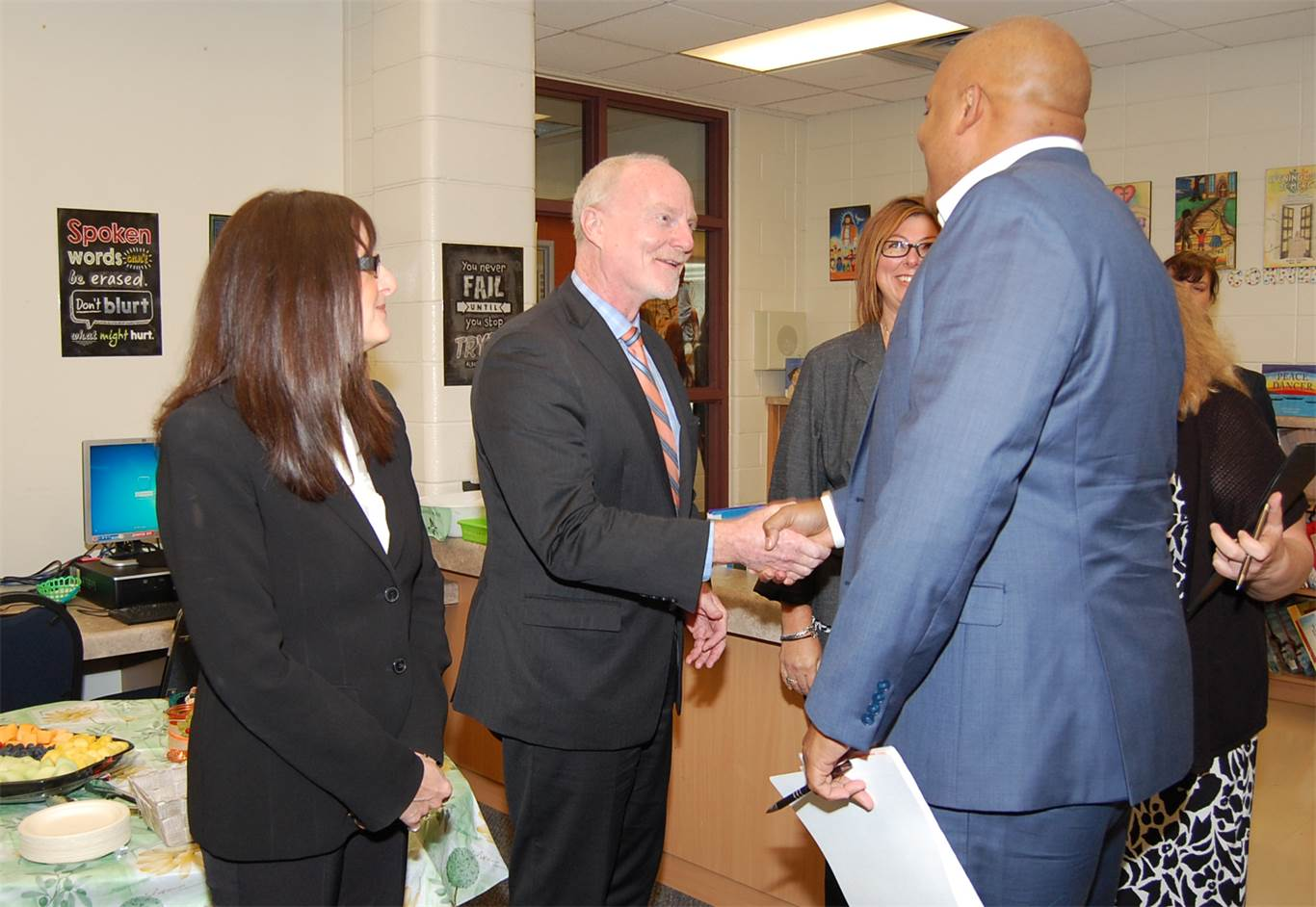 Minister of Children and Youth Services Michael Coteau is greeted by Director of Education David Hansen.